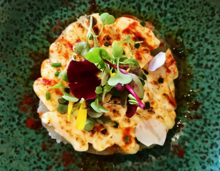 Timbal de bacallà amb ceba confitada i patates